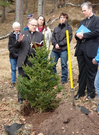 In this Greg Peterson photo from the Cedar Tree Institute site, Northern Great Lakes Synod Lutheran Bishop Thomas A. Skrenes blesses one of the trees faith congregations planted on Earth Day, 2009.